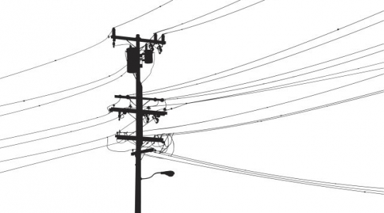 Detailed utility pole silhouette with street light, transformers and cables.